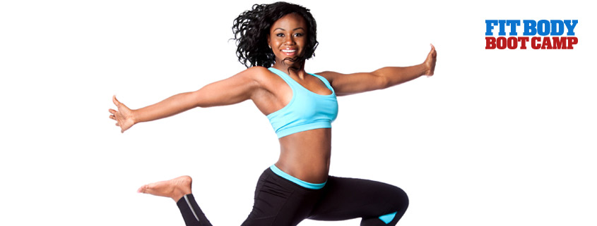 Woman in black and blue work out clothes jumping in the air